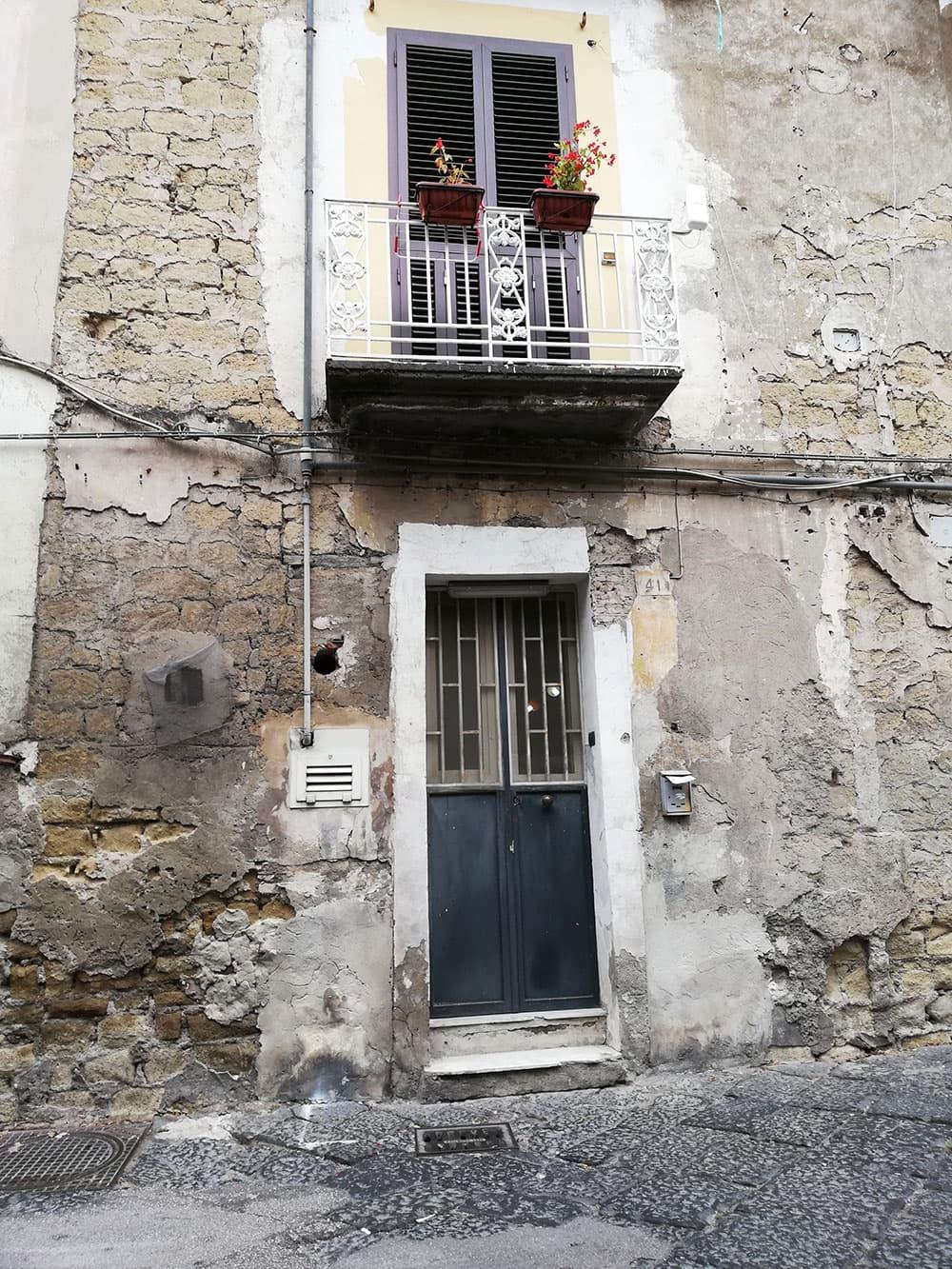 A crumbling facade in Naples