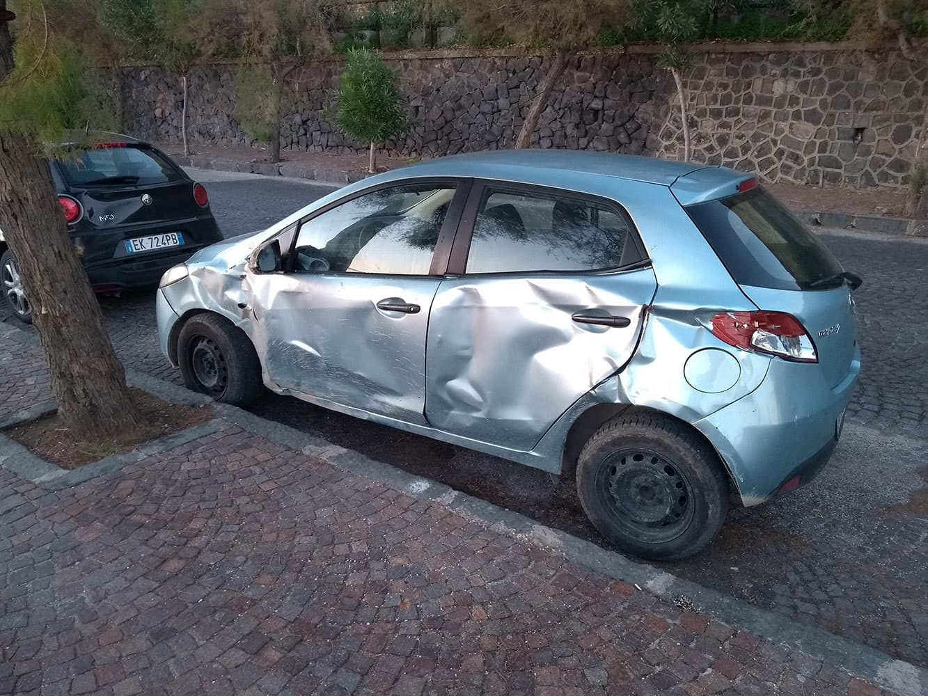 Dented cars in Naples are everywhere!