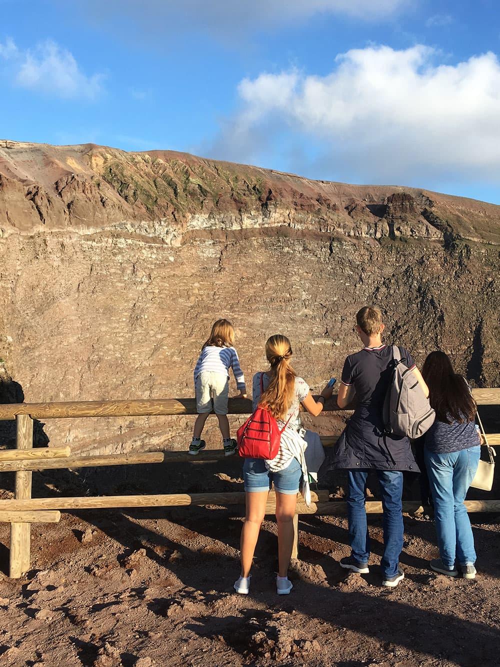 Tourists looking into Vesuvius's crater