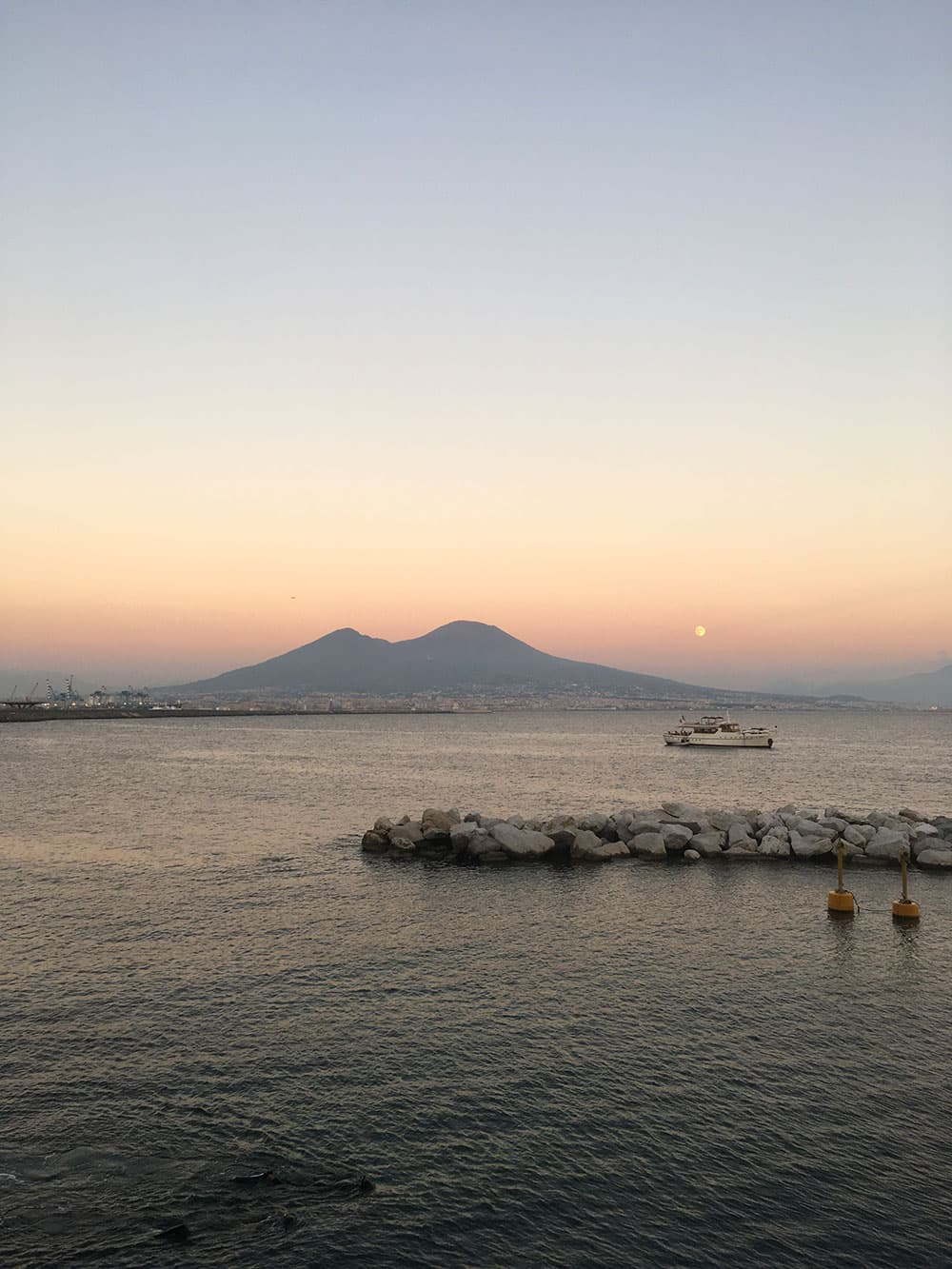 Sunset with moon above Mount Vesuvius