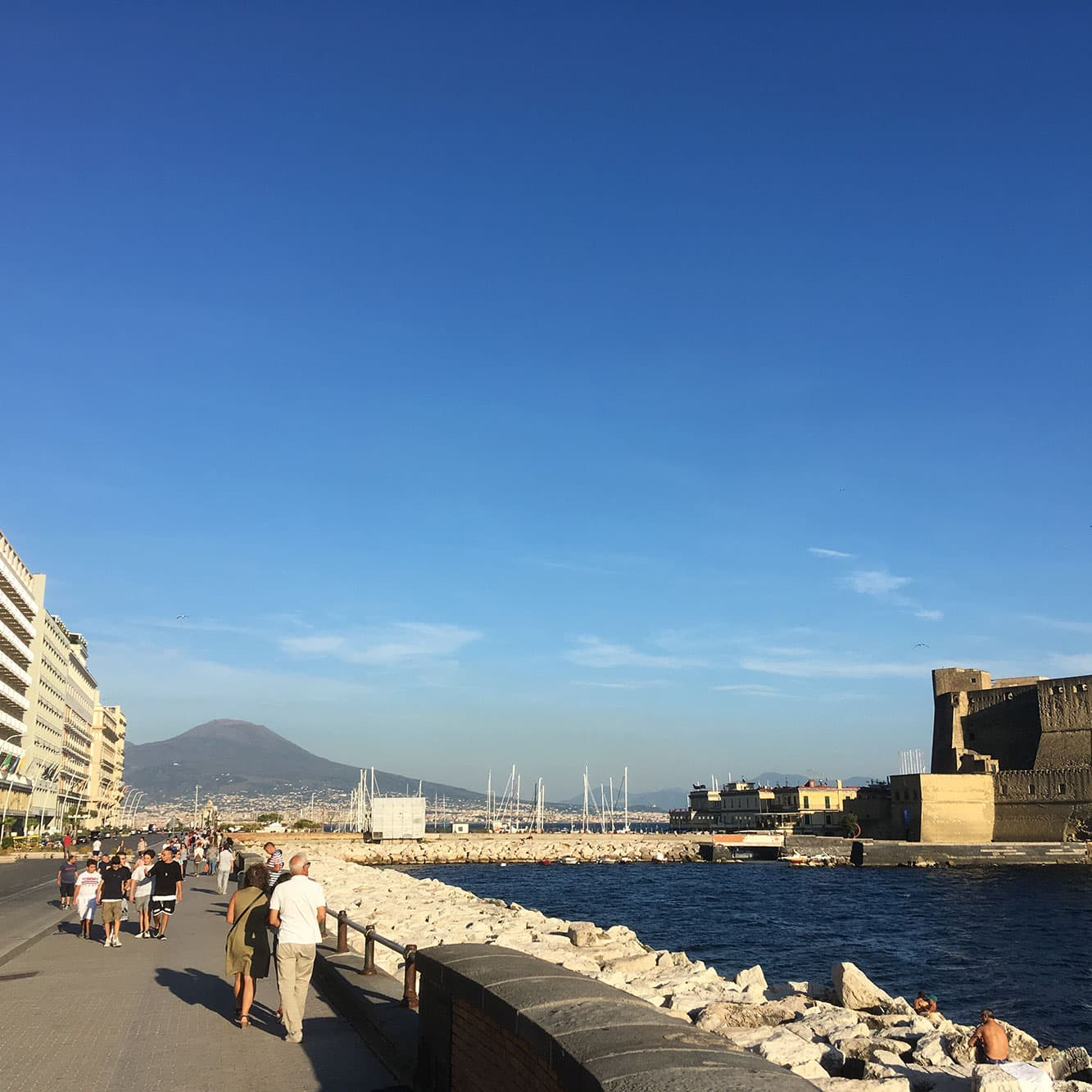 Naples's Lungomare seafront walk with bridge to fort