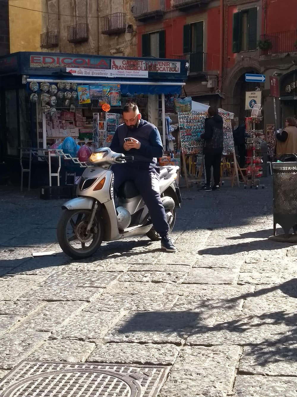 A local on a scooter in Naples