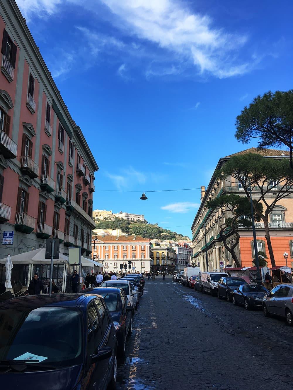 Walking towards Piazza del Plebiscito (Castel Sant'Elmo on the hill)