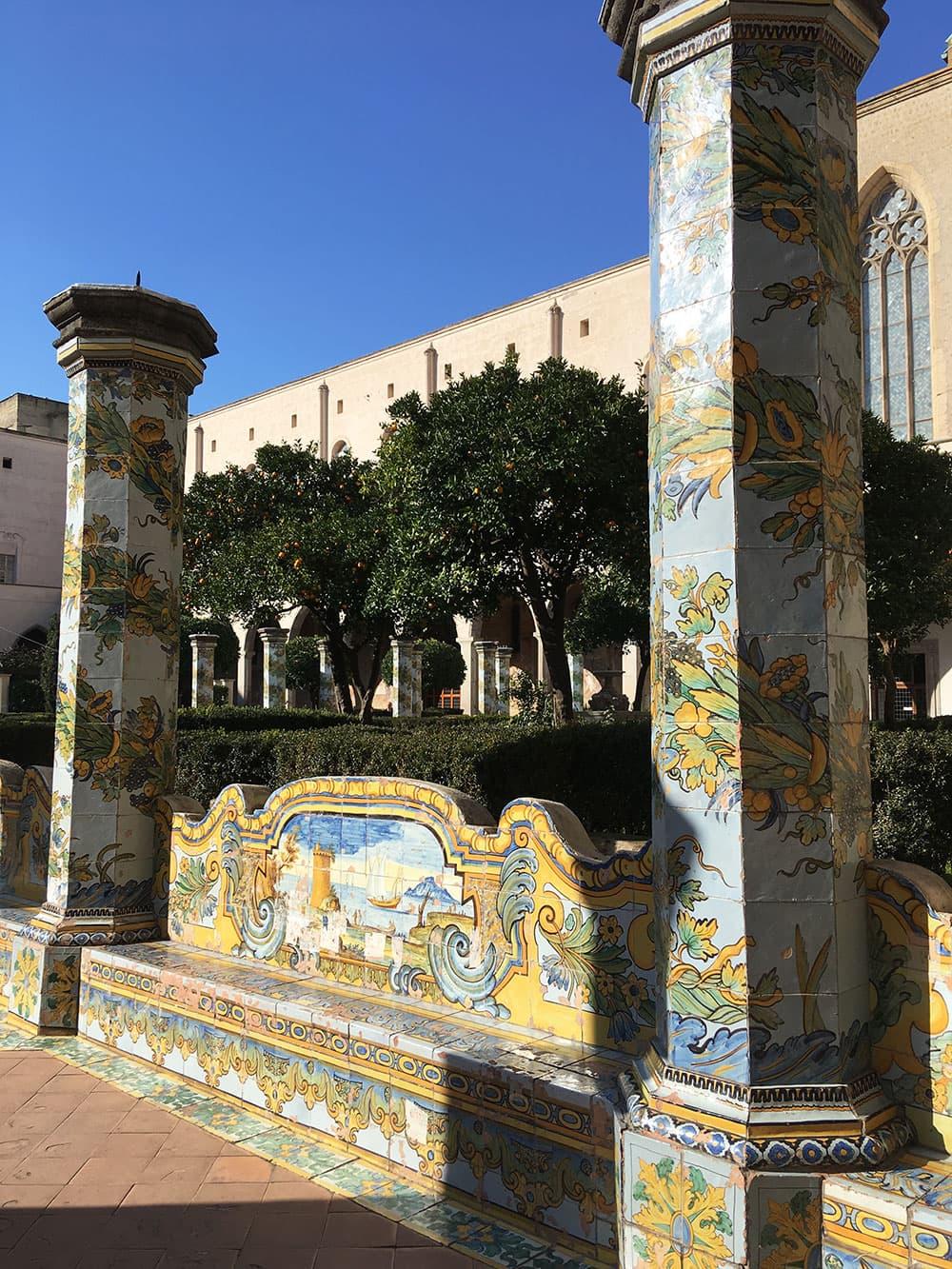 Tiled columns and a bench at Santa Chiara